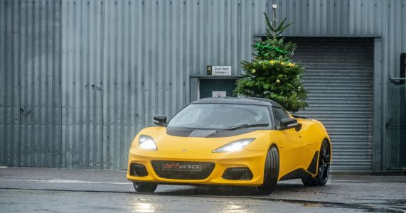 Lotus Wishes You A 'Merry Driftmas' With A Tree-Carrying Evora