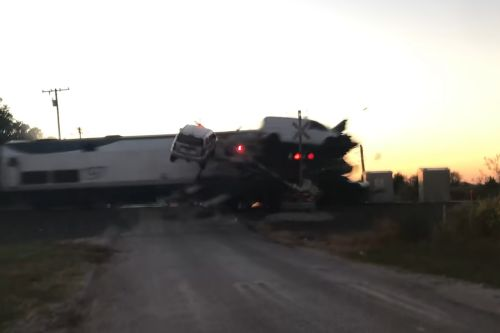 Watch Vehicles Fly After Train Smashes Into Car Hauler