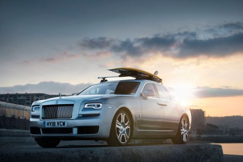 A Rolls-Royce With A Surfboard On The Roof Is Not Exactly Common