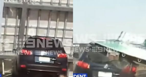 Driver Escapes With Minor Injuries After Huge Sign Drops On Her Car