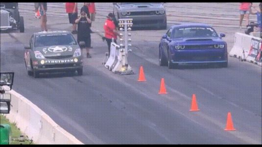 Watch A Hellcat Powered Prius Destroy A Dodge Demon In A Drag Race